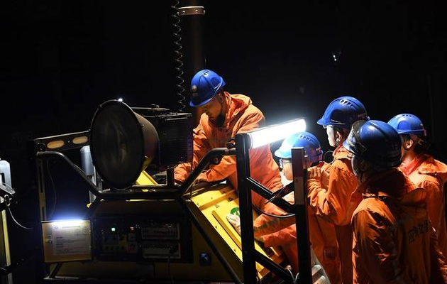 12 workers trapped in China mine blast are alive