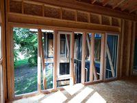 Maison ossature bois sur pilotis métal