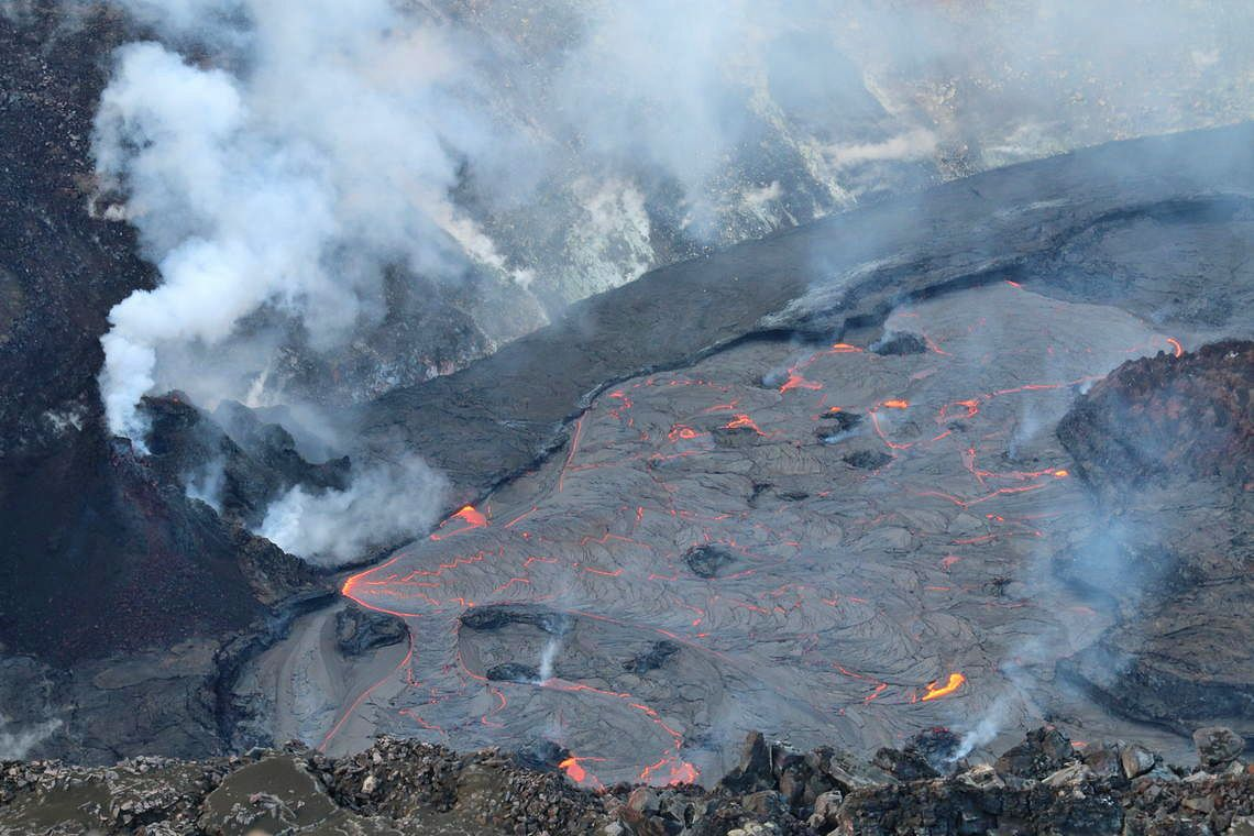 Kilauea - Helema'uma'u - The active western side of the lake exhibited numerous surface eruptions and a dark crust. Lava effusion continues into the lava lake from the base of the west vent (left). USGS photo taken by K. Lynn.