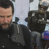 Keanu Reeves sports a graying beard as he rides his motorcycle