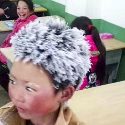 Chine :  à 8 ans, il marche 1 heure par -9° pour aller à l'école