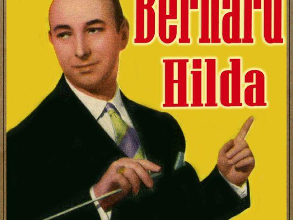 Bernard Hilda, né dans une famille de mélonames, il deviendra chef d'orchestre et chanteur de de jazz puis il se spécialisa en musique de cirque