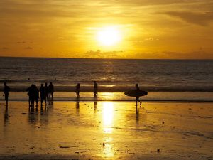 First day back in Paradise... with a beautiful sunset on the busy Kuta beach