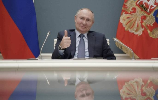 Putin signs law allowing him to serve two more terms