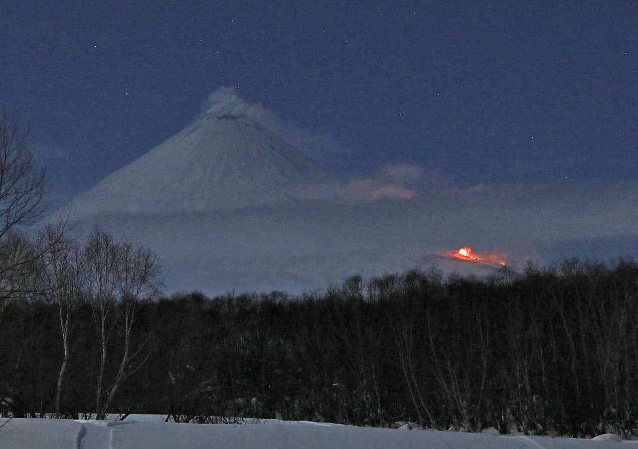 Klyuchevskoy - light plume of ash at the top and low location of the active eruptive site - photo Yuri Demyanchuk