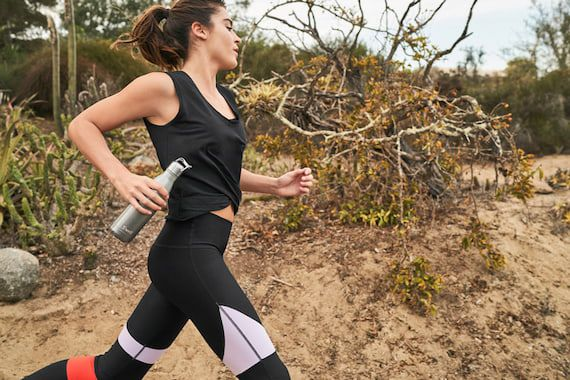 woman-running-with-water-bottle