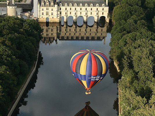 visitheworld:  Chenonceau Castle and a ballon reflected on the Cher river, France (by kLe).