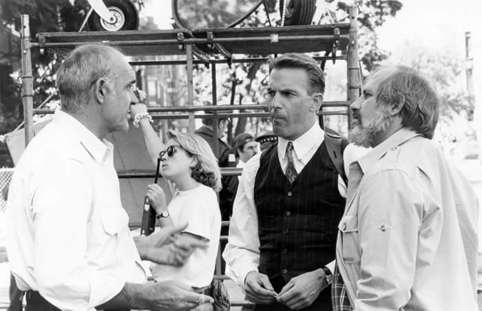 """Mr. Connery on the set of """"The Untouchables"""" with the movie's star, Kevin Costner, and director, Brian De Palma. Mr. Connery won an Academy Award for his performance as a streetwise police officer.Credit...Sunset Boulevard/Corbis via Getty Images"""