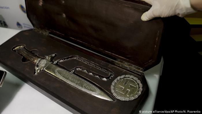"Nazi artifacts found in Argentina Medical device : This medical device was used to measure head size. ""There are objects to measure heads that was the logic of the Aryan race,"" said Argentine Security Minister Patricia Bullrich. - Nazi statue This statue of a ""Reichsadler"" (Imperial Eagle) was also part of the discovery. The eagle was one of the main symbols of Nazi Germany.- Bust of Hitler Perhaps the most noteworthy discovery was this bust pressing of Adolf Hitler. The inscription reads ""Our Leader Adolf Hitler"". - Knife This knife with Nazi markings was also part of the collection. Authorities are still determining to whom these artifacts belong. - Box of harmonicas Argentine police also discovered this box with swastikas containing harmonicas. Bullrich said these, along with other toys"