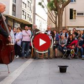 A little girl gives coins to a street musician and gets the best surprise in return