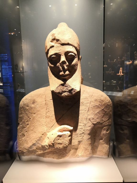 Bust of bearded male figure wearing a conical crested cap, Limestone, Cypro-Archaic II, mid 6th century BC.