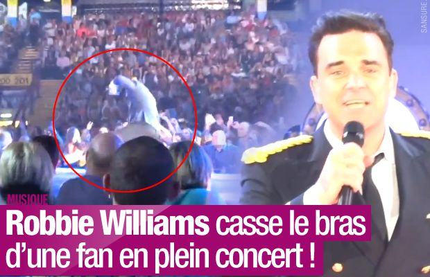 Robbie Williams casse le bras d'une fan en plein concert ! #RobbieLive