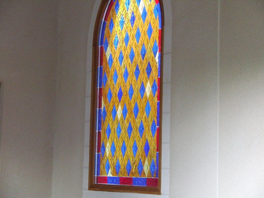 Window in the cloister of my monastery. The coloured losanges are glued inside a double glazed window.