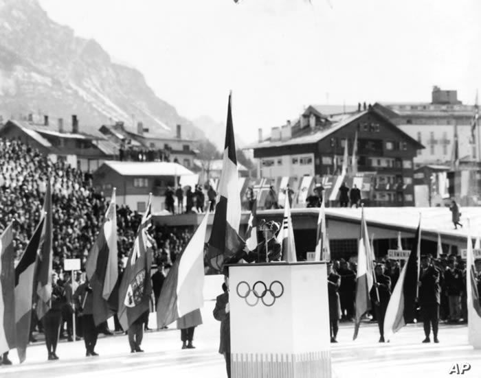 FILE - Italian Alpine skier Giuliana Chenal-Minuzzo reads the Olympic oath, on behalf of all the athletes taking part, at the opening ceremony of the seventh Winter Olympic Games, at Cortina, Italy, Jan.26, 1956.