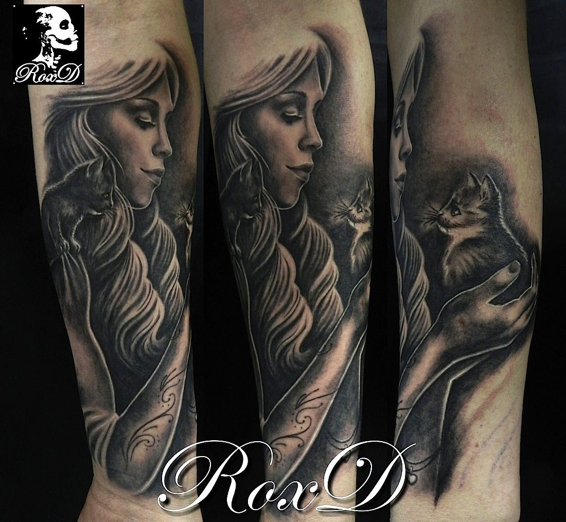 woman with cats tattoo by RoxD