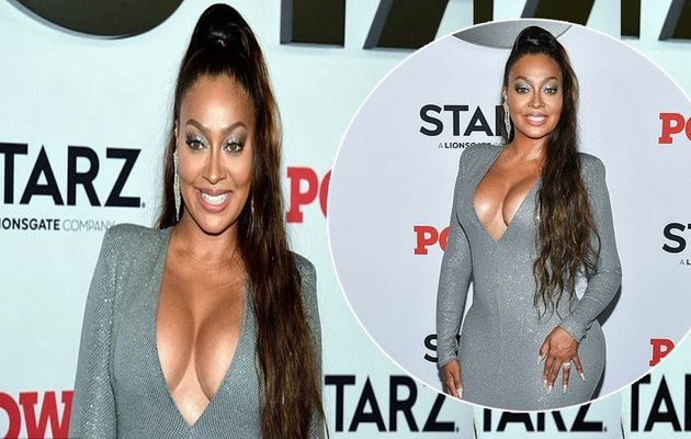La La Anthony flaunts her curvaceous figure in a shimmering silver dress for the Power final season premiere