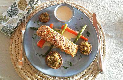 Truite en croûte de noisettes, champignons farcis, asperges vertes et carottes glacées
