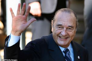 Emmanuel Macron pays tribute to Jacques Chirac and Eiffel Tower is plunged into darkness as France mourns its former playboy president following his death aged 86