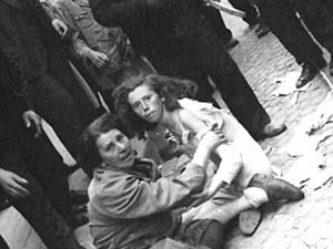 A Jewish man is kicked to the ground during a pogrom in the Ukrainian city of Lviv in 1941 (left). Philippe's grandfather Leon Buchholz was born in the very same city in 1904, and most of his family were still there. His relatives will have been subjected to beatings and humiliation, like these women, before finally being marched out of the city to be shot (right)