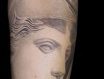 athena tattoo arm