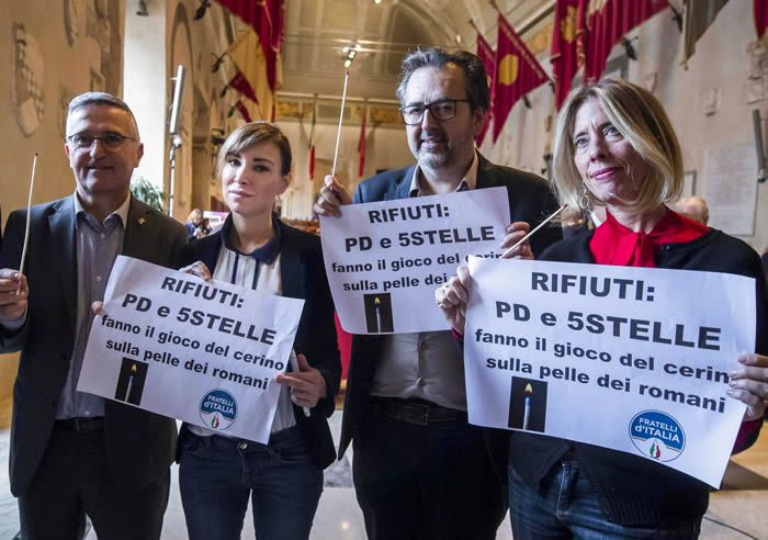 Town councilors in Rome from the Brothers of Italy party — including Rachele Mussolini, second from the left — hold a protest over waste management during a city council meeting in Rome in December 2019. (ANSA/AFP/Getty Images)