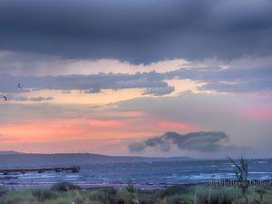 Reflets d'un ciel d'orage sur l' étang du Barcarès. Copyright. (C) Philippe Dubedat.