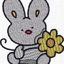 Broderie printemps 9: petit lapin vous offre une fleur !