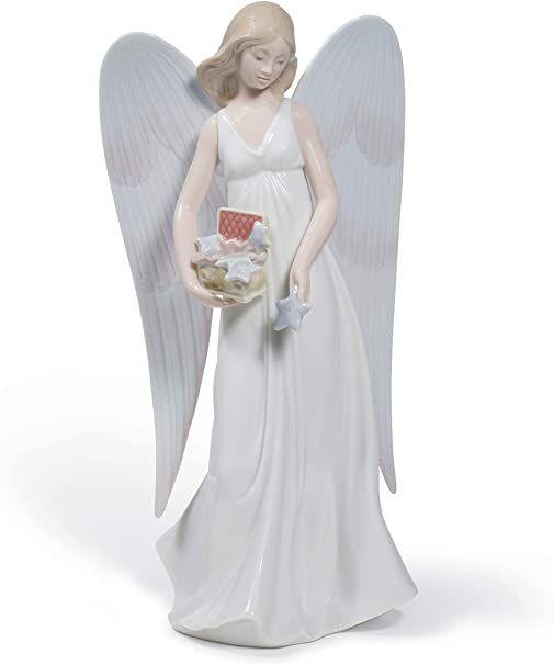 Le petit ange au sommet de l'arbre de Noël ♥
