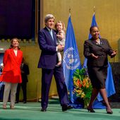 French Minister Royal Looks on as Secretary Kerry, With His Granddaughter, Walks Across the Stage to Signing the COP21 Climate Change Agreement on Earth Day in New York