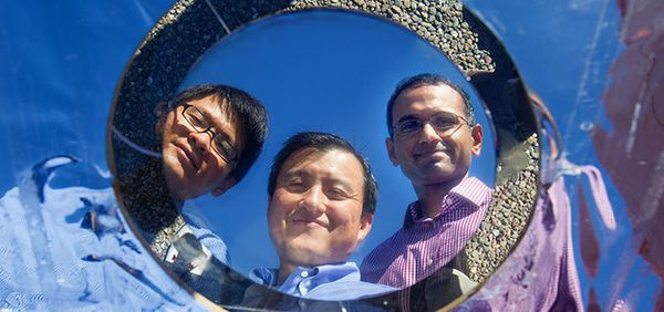 Doctoral student Linxiao Zhu, electrical engineering professor Shanhui Fan and research associate Aaswath P. Raman are Stanford engineers who have developed a thermal overlay to cool solar cells.  Credit Stanford Engineering.