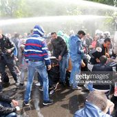 Police use water cannon to disperse people arriving for the banned anti-Semitic congress, 'First European Conference of Dissidence', organised by Chamber member Laurent Louis in Anderlecht, outside...