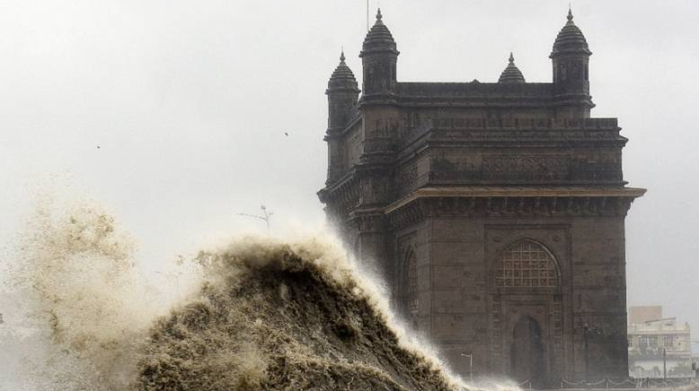 Authorities urged people to stay indoors as huge waves battered the city's seafront.