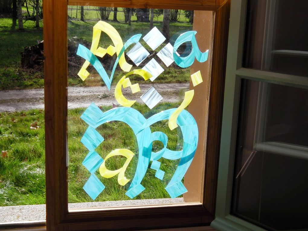A three-tierred window. 80 cm x 50 cm. In some of the photos I've separated the elements. the text is Ave Maria (Hail, Mary). The letters are glued on to clear glass. The background coloured glass is held in place sandwiched between two sheets of clear glass.