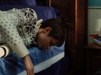 Andy climb on his bed, the phone falls on the floor and he cannot answer the call of his mother => In order to become autonomous he has to let her deal with her anxiety on her own.