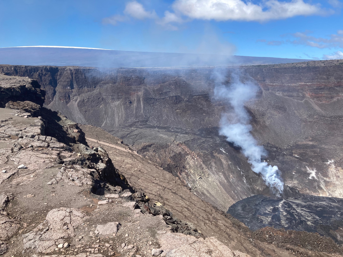 The eruption at the top of Kīlauea continues with the western vent supplying lava to the active western lava lake of Halema'uma'u. Snow from a recent storm can be seen on the summit of Mauna Loa volcano in the upper left corner of the image. - photo M.Patrick - USGS