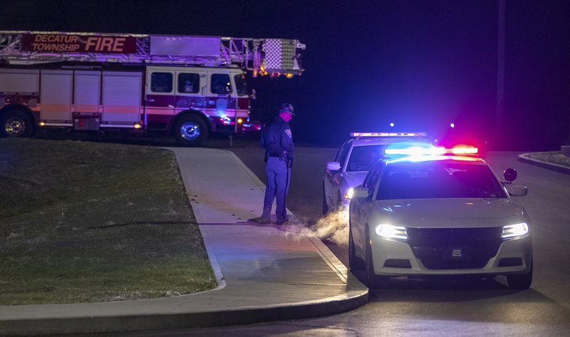 Police and fire teams arrive at the scene outside a FedEx facility in Indianapolis where multiple people were reportedly shot at the FedEx Ground facility early Friday, April 16, 2021, in Indianapolis, Indiana. Multiple people were shot and killed in a late-night shooting at a FedEx facility in Indianapolis, and the shooter killed himself, police said. (Mykal McEldowney/The Indianapolis Star via AP)