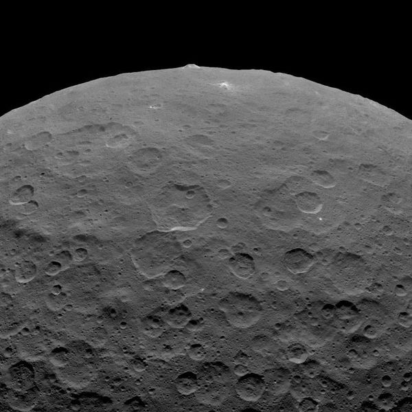 Dawn Survey Orbit Image 10 - ORIGINAL ROTATED-180° - via JASC Paint Shop Pro v6.02 http://photojournal.jpl.nasa.gov/catalog/PIA19578 This image, taken by NASA's Dawn spacecraft, shows an intriguing mountain on dwarf planet Ceres protruding from a relatively smooth area. Scientists estimate that this structure rises about 3 miles (5 kilometers) above the surface. Dawn captured this image from an altitude of 2,700 miles (4,400 kilometers). The image, with a resolution of 1,400 feet (410 meters) per pixel, was taken on June 14, 2015