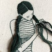 sheena liam, model and embroiderer, sculpts her hair with loose thread
