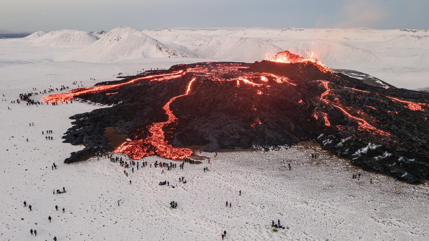 """Reykjanes Peninsula- the Meradalur site surrounded too closely by visitors - note the """"reservoir"""" formed near the cone which can suddenly release large amounts of lava - photo SkyAlert"""