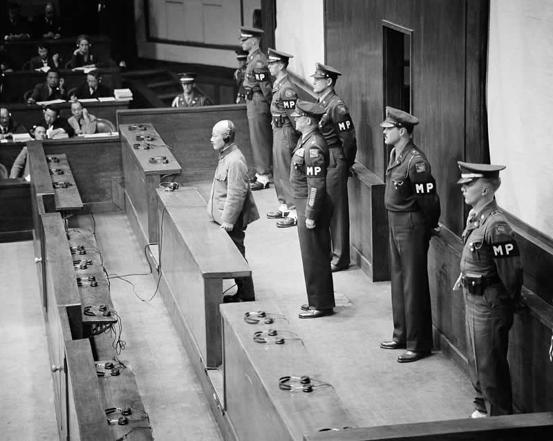 Hideki Tojo, former prime minister of Japan and war leader, stands in the dock before the International Military Tribunal in Tokyo, 1948. Photo / AP