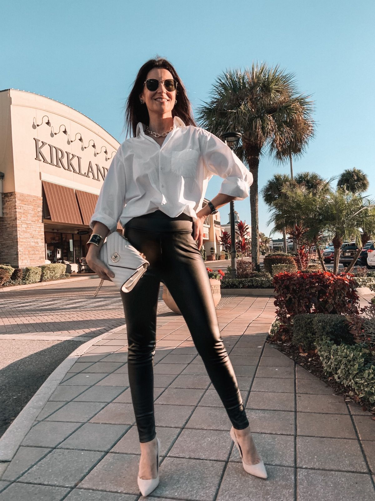 Faux leather leggings with white button-Down Shirt