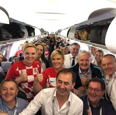 Croatian President flies economy to celebrates in front of Russian PM after knocking the hosts out of the World Cup