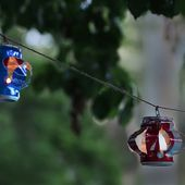 Upcycle Your Soda Cans Into These Charming Hanging Lanterns | eHow.com