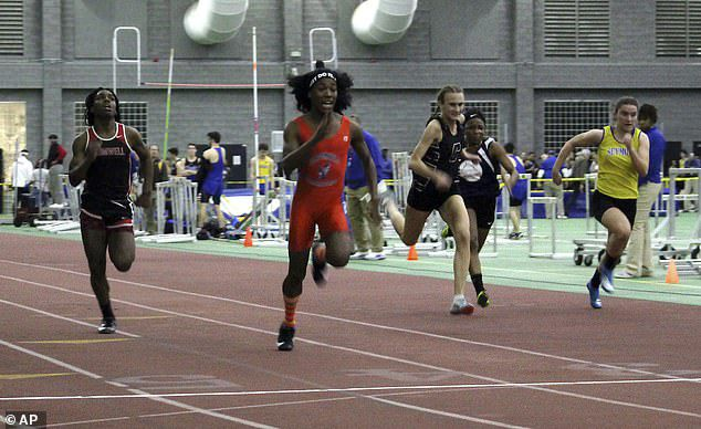 Bloomfield High School transgender athlete Terry Miller, second from left, wins the final of the 55-meter dash over other runners ata Connecticut girls' track meet in February 2019
