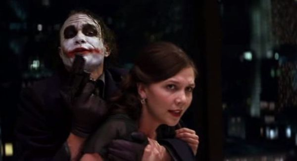 "Rachel waves her head ""no"" when Joker asks him to remove his mask. She doesn't want him to do it to save her life, she wants it as a proof of romantic love for her. She is ready to die in order to know whether Bruce loves her or not."