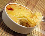 Un plato ligero para combatir el frío: Gratén de patatas y cebolla con leche