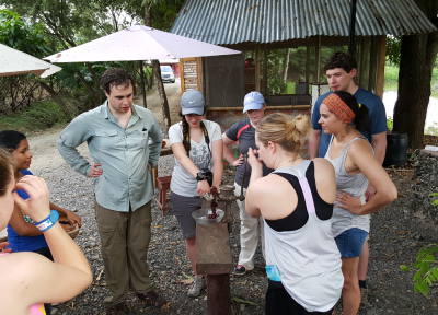Students from Iowa Grinding cacao to prepare Chocolate of Manually form