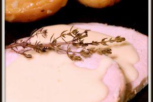 Rôti de porc au thym, crème d'ail et rattes fondantes