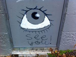 """En tag ou en autocollant sur du mobilier urbain, """"See You"""" apparaît sous différentes formes."""