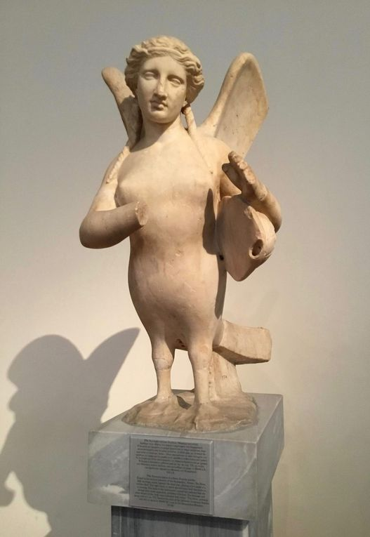 Funerary statue of a Siren. Pentelic marble. Found in the ancient cemetery of Kerameikos. 370 BC.